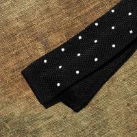 A Black silk scarf with white polkadot tie